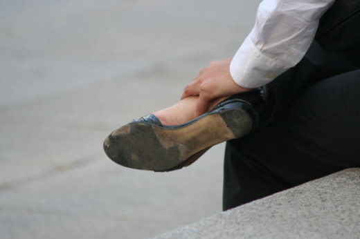 Bad shoes can cause a painful cramp in one or both of your feet. Be sure to trash your shoes and get some new ones immediately if you find that they are making things worse.
