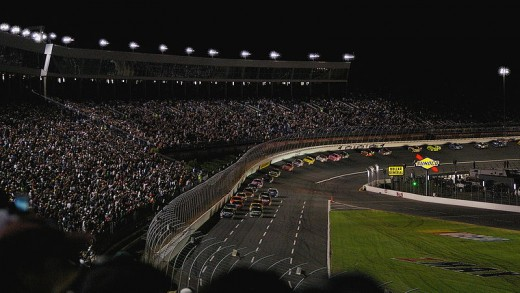 Night racing at Charlotte Motor Speedway is popular. Here is a view from the quad-oval area, watching cars as they exit turn 4.
