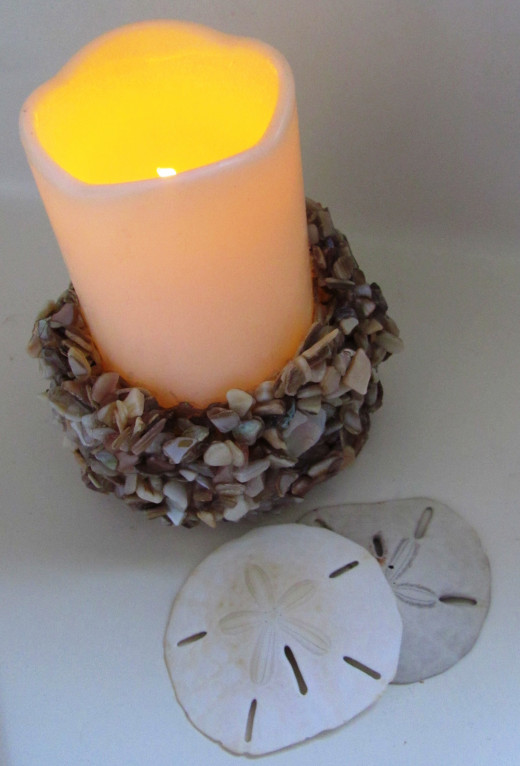 This LED candle gives the appearance of a flame without the hazards of a wicked candle.