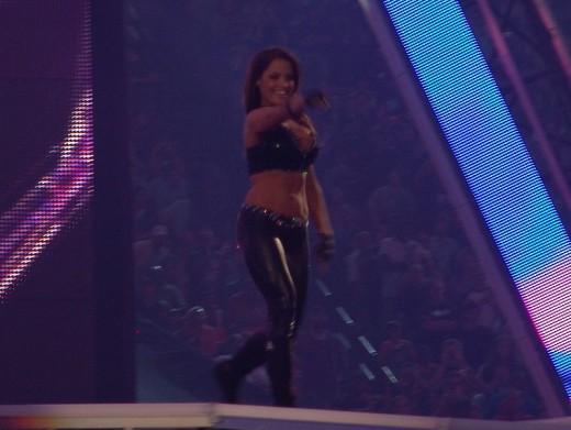Trish Stratus performing at  her entrance at WrestleMania XXVII