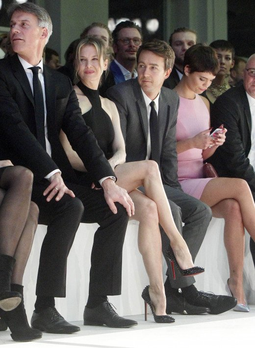 Renee Zellweger proper legs cross of her very toned legs at Hugo Boss fashion show.