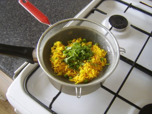 Coriander/cilantro is added to drained rice