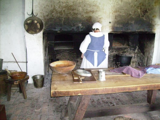 Cook preparing meal for the troops in kitchen of French Castle at Old Ft Niagara.