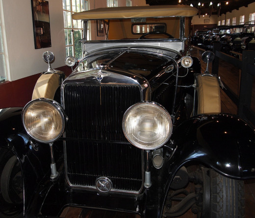 Fisher manufactured car head lamps, like these on a 1927 La Salle.