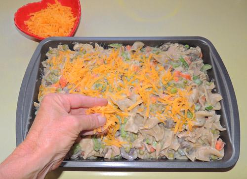 top with shredded cheddar