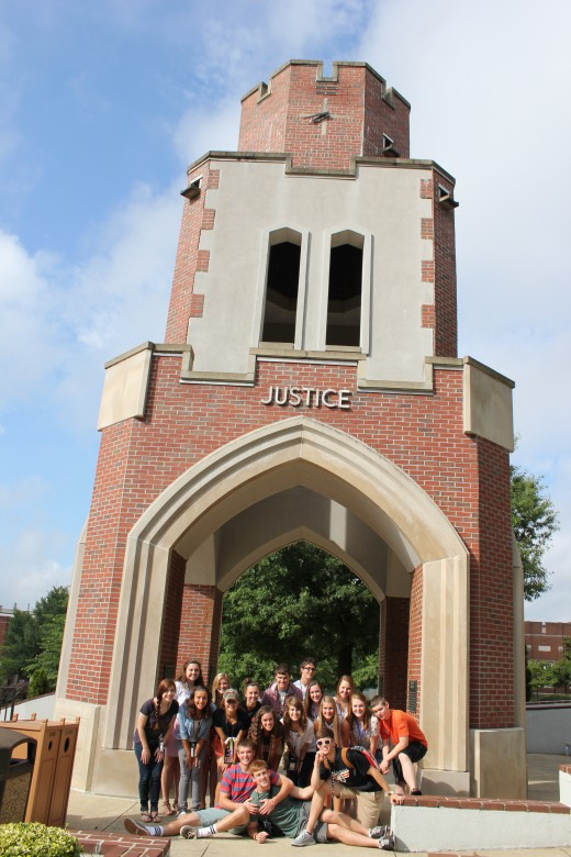 Journalism students in front of the Bell Tower.