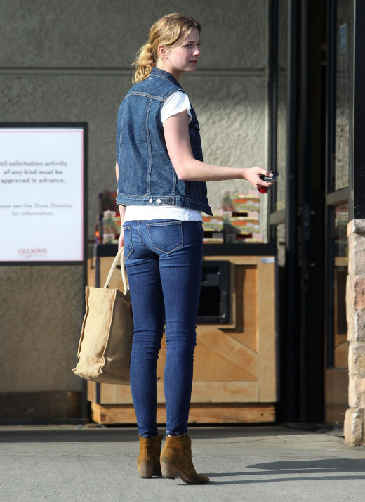 Emily VanCamp long legs in tight jeans