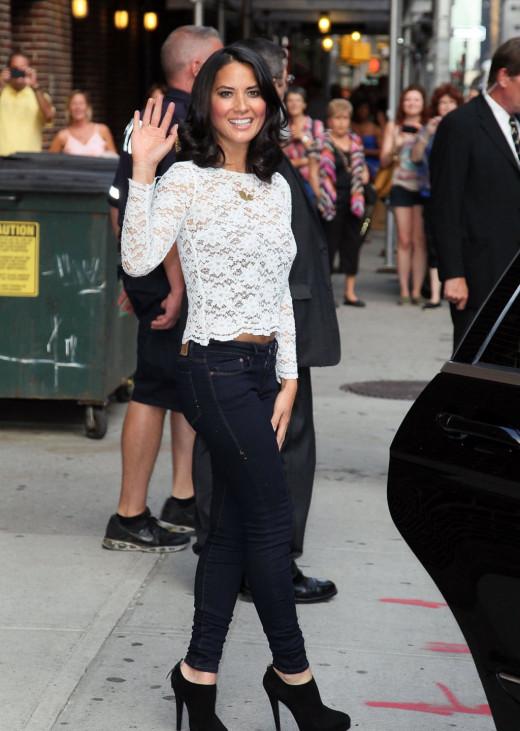 Olivia Munn in dark jeans and high heels
