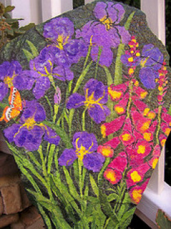 How to Stencil Flowers onto a Garden Rock