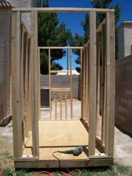 The front wall includes a 24 inch wide opening for a door, with one foot of wall on each side.