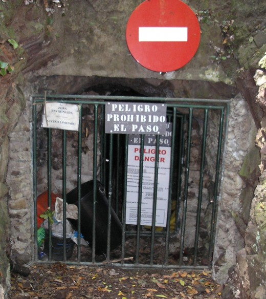Closed off entrance to the Piedra de los Cochinos mining tunnel where six people died from poison gases.