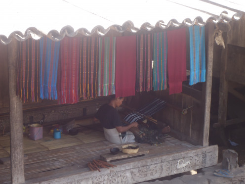 Flores: A villager doing Ikat weaving making an Ikat bag by traditional methods and a traditional Ikat pattern.