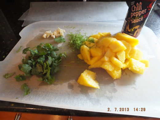 The salsa is super quick. Just peel and chop the mango, dice the garlic, quick chop the cilantro, squeeze the lime and shake in the the chili sauce. So easy!