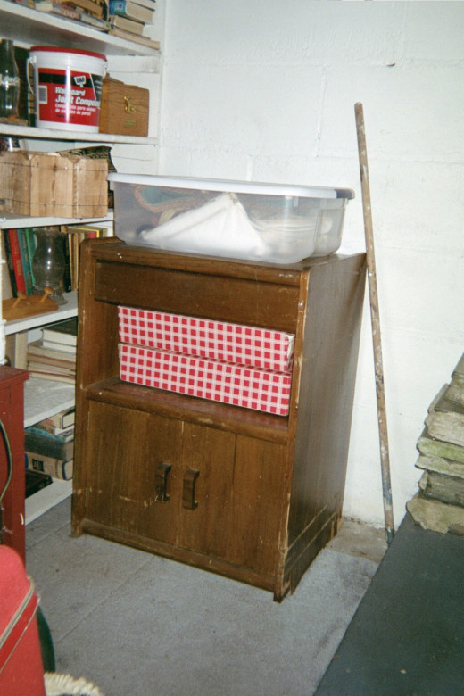 Cabinet found down alley sitting at the bottom of the basement stairs.