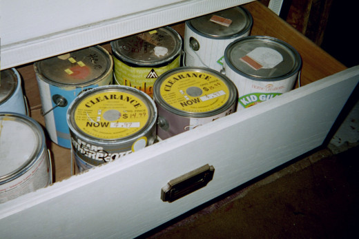 One of the drawers holding 8 gallon cans of paint.