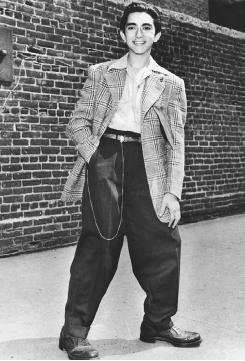 A slightly-built teenager gains some extra size and kudos with a zoot suit