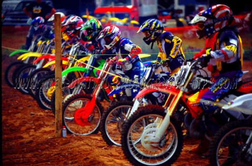 Some colorful motocross action. I enjoy Motocross photography, because of the bright colors and the good action of dirt flying and motorbikes jumping through the air, and then of course the crowded start line looks cool also.