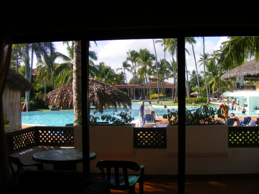 This is the view looking out onto the patio from the sitting area. Overlooking the main pool.