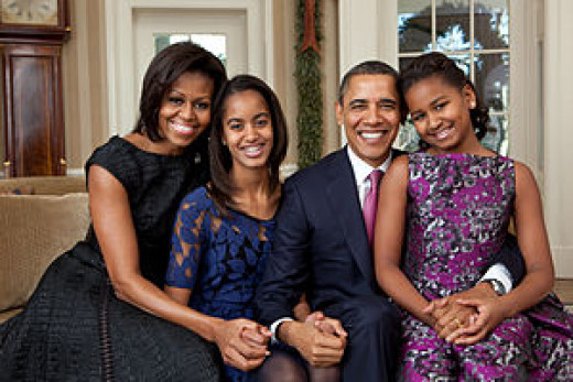 The President with his wife and two beautiful daughters.