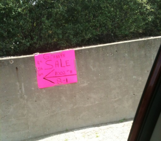 Now this is a garage sale sign! It's really close to the road too.