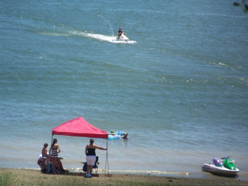 Jet skis and boating are popular activities at the lake.