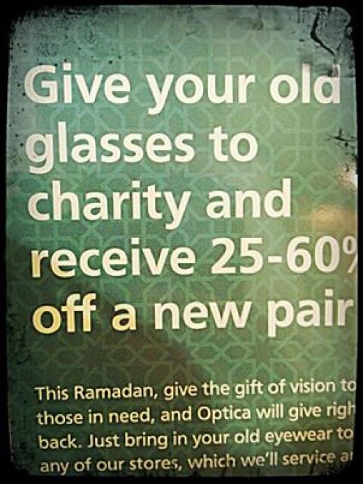 An advertisement of an optical shop promoting charity during Ramadan 2013.
