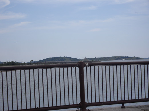 A glimpse of the Head Island Causeway in the distance, and one of the Harbor Islands beyond that