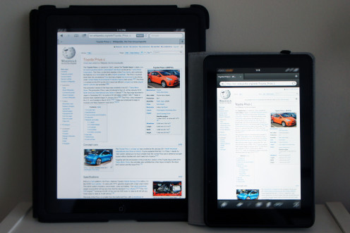 Amazon Kindle Fire (right) compared with iPad (original, left), both displaying the English Wikipedia main page.  The Wikipedia screenshot is licensed under GPL and any other material that might be copyrighted (icons, logos, etc) has been blurred.