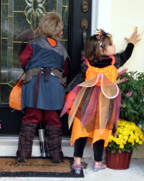 Taking pictures of kids Trick-or-Treating is a fun way to capture Halloween photos.