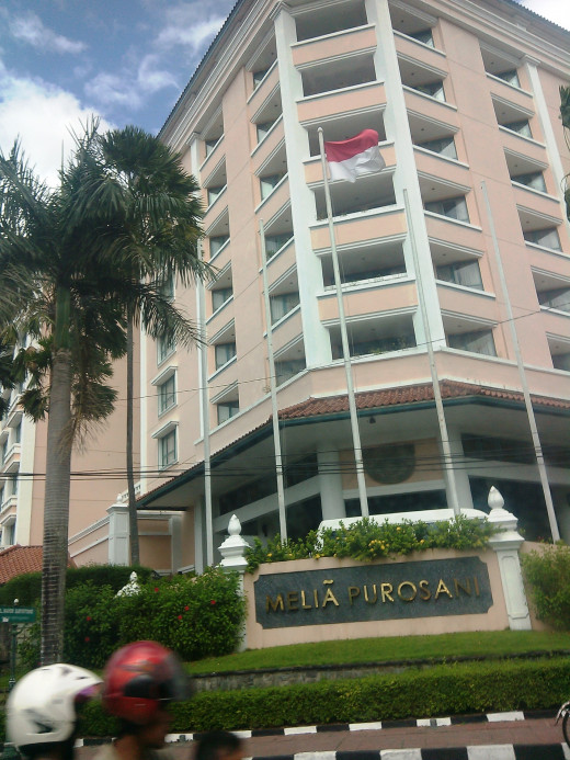 in front of the Melia Purosani hotel in Jogjakarta, Indonesia. Photo taken from our car. ;)