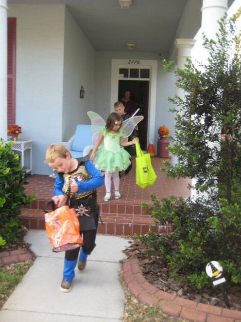 Photos of kids inspecting their treats and Trick-or-treating are great action shots.  Just make sure there is enough lighting.