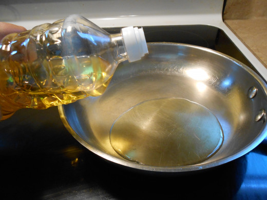 1 Tbsp of vegetable oil should be just enough to cover the bottom of your stainless steel skillet and saute onions and corn tortillas.