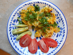 Serve prepared migas topped with fresh cilantro with sliced avocado and tomato on the side. Delicious!