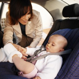 Always buckle baby into a car seat meeting your state's safety guidelines.