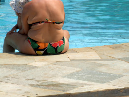 This type of figure poolside is becoming the norm, yet it is an indication of obesity.