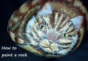 The first cat rock I ever painted. He looks a tad irritable!