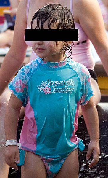 Child  with UV sun protective swimwear