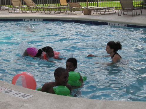 Members of the Graves family enjoy the swimming pool before the barbeque.
