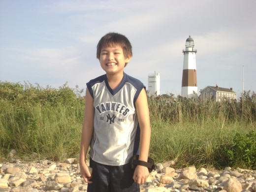 Matty in front of lighthouse at Montauk point, Long Island