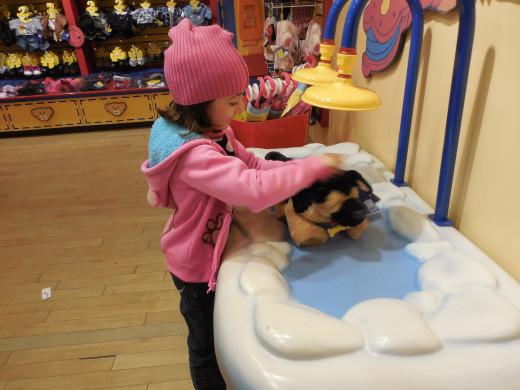 Kaelan 6 years old, washing her little Smokey at Build A Bear Jan 2013