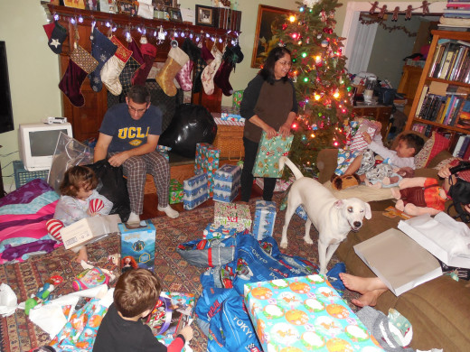 The family unwrapping begins. Everyone is happy!