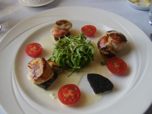 Pan fried scallops on black pudding