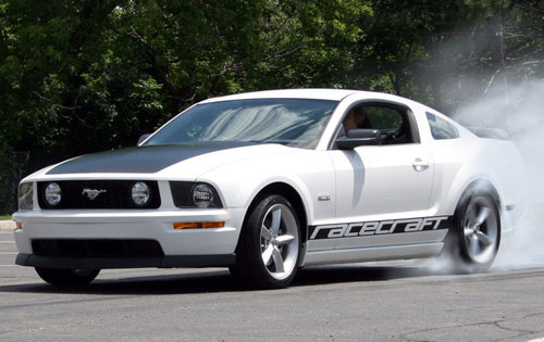 A white Saleen Racecraft 420S in action. Based on the Ford Mustang GT, the Racecraft 420S is a great performance bargain for enthusiasts looking to modify their Mustangs. Plus it comes with a factory warranty from Saleen!