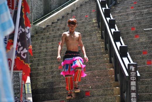 It is a man dressed up in traditional cloth.