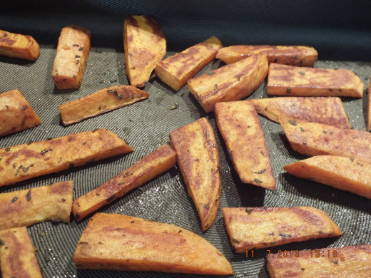 Heat your oven and pan to 425 degrees. Take the pan out of the oven and add the fries. Place back in the oven.