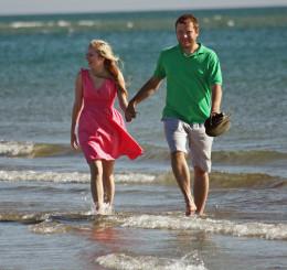 Happy couple in stylish summer clothing