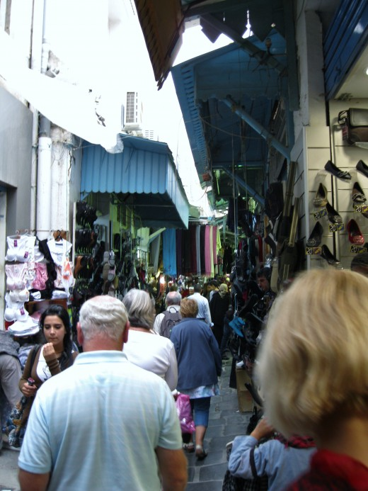 Shoppers in the narrow alley that constitutes the old souk in Medina of Tunis.