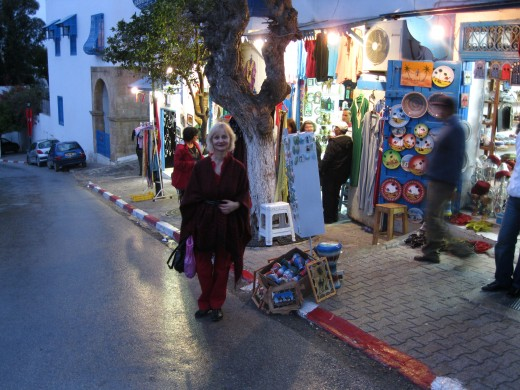 My wife outside shop in the Souk De L'Artisant in town of Sidi Bou-Said next to Carthage, Tunisia