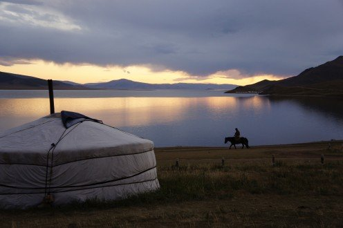 This is Mongolia! A lone Mongolian horseman ambling past the shores of White Lake (Khorgo-Terkhin Tsagaan Nuur National Park).