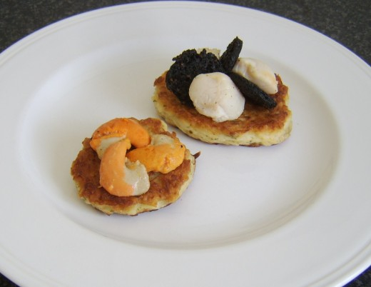 Assembling scallops and black pudding on potato cakes